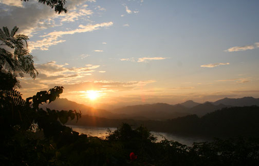 The sun sets over the Mekong
