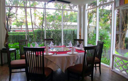 The elegant dining room overlooks the restaurant's gardens where many of the fresh herbs used by the chefs are grown.