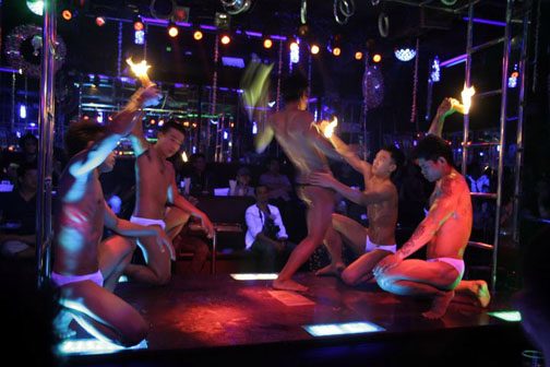 Getting up close and personal with a bar boy is what one night in Bangkok is all about.