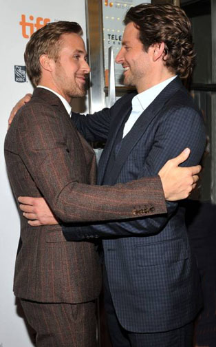 Gosling trades hugs and phone numbers with an unidentified gay man at a recent Hollywood industry party.