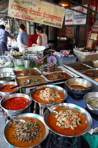 Seeing street food in Bangkok is not an experience. Eating it is.