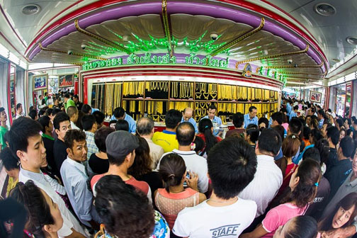 The scrum that is buying gold in Chinatown is comparable to the melee that would be caused by a Sunee bar selling beer at 25 baht.