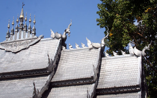 Fanciful chofah creatures at the Silver Wat in Chiang Mai include an elephant.