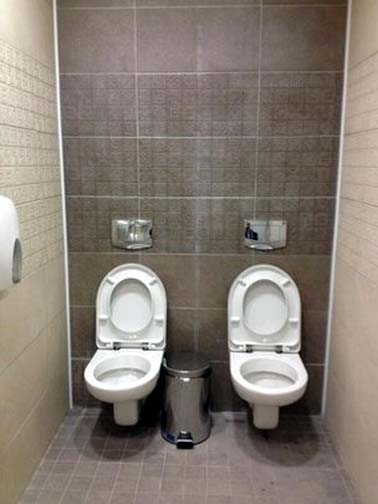 You call it a space-saving cubical, gays into scat and golden showers call it a little slice of heaven.