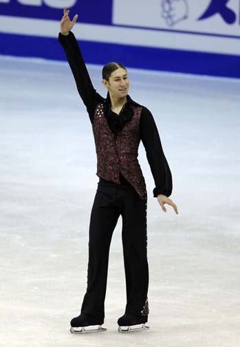 Because it's difficult to moon walk on ice skates, Jason channels John Travolta and strikes a Saturday Night Fever pose instead.