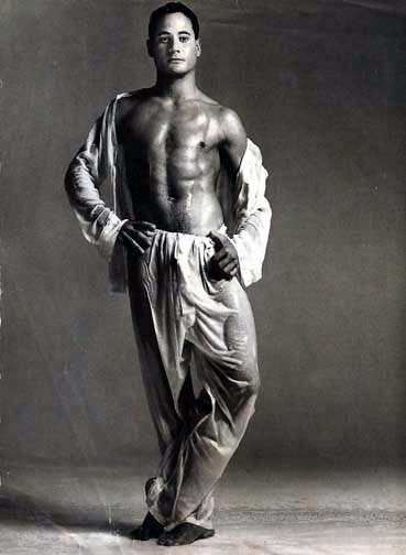 Olympic Diver Greg Louganis strikes a come do me pose for GQ