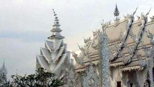 You'd have to be familiar with Wat Rong Khun to pick out the exterior damage to the temple.