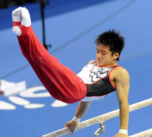 Japan's Yuya Kamoto, a Rings specialist, flies high on parallel  bars too and is sure to medal for over-all cuteness at the XVII Asiad.