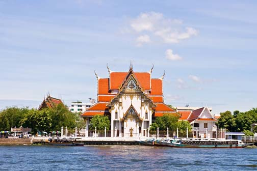 Wat Rakang may not look like much from the  Chao Phraya River, but that's because your eyes are usually drawn to its neighbor, Wat Arun, instead.