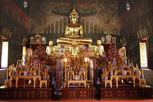 Wat Rakang's presiding Buddha image is known as Phra Prathan Yim Rap Fa, but its power is overshadowed by the temple's famous Phra Somdej amulets.
