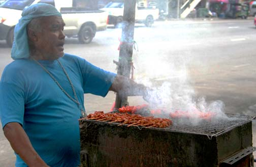 Forget about spotting a pair of golden arches, in Bangkok the real treat is found under a cloud of aromatic barbeque smoke.