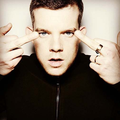 Russell Tovey is glad he's not visibly gay and has an opinion for those who think he should be.